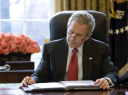 bush_at_desk_reading_sotu_draft3